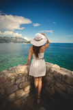 Rear view shot of young woman looking on the horizon at sea Royalty Free Stock Photography