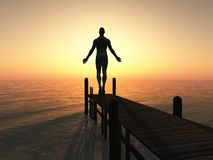 Silhouetted man on pier. Rear view of silhouetted man on pier with sea and sunset background Royalty Free Stock Photography