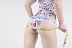 Rear view slender girl in a flowery bodysuit. Stock Photo