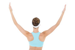 Rear view of slim brunette woman wearing sportswear raising her arms Royalty Free Stock Images