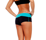 Rear view of slim girl with fitness clothes Royalty Free Stock Image