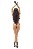 Rear view of slim girl in thong and leather gloves Royalty Free Stock Photos