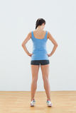 Rear view of a slim woman tip toeing Stock Photo