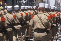 Rear View of Soldiers Marching Stock Image