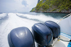 Rear view of speed boat running over sea water for traveling des Stock Photo