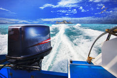 Rear view from speed boats running against clear sea blue water Royalty Free Stock Image