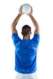 Rear view of sports player throwing ball Royalty Free Stock Image
