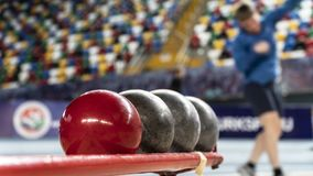 Rear view sportsman practising shot put against. View of a stadium royalty free stock image
