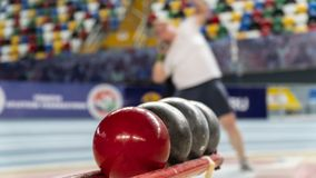 Rear view sportsman practising shot put against. View of a stadium stock photography