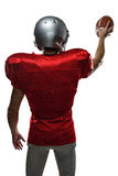 Rear view of sportsman in red jersey holding ball Stock Photo