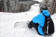 Rear view of sportsman with snowboard Stock Photo