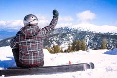 Rear view of sportsman with snowboard standing on top of mount Royalty Free Stock Images