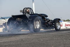 Drag racing. Napierville september 13, 2014 rear view of vintage drag car making a burnout on the track during drag event Stock Photos