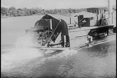 Rear view of steam boat traveling down river stock video footage