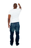 Rear view of strong man pointing at copyspace Royalty Free Stock Image