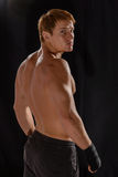 Rear view of strong young male boxer Stock Images