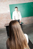Rear View Of Student In Classroom Stock Photo