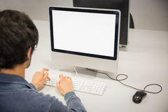 Rear view of student using computer Stock Image