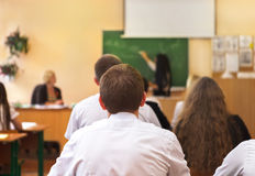 Rear view of students in the classroom Stock Photos