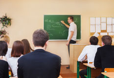 Rear view of students in the classroom Stock Photo