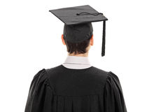 Rear view studio shot of a male college graduate Stock Image