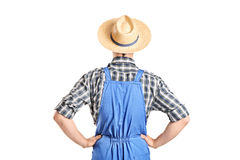 Rear view, studio shot of a male farmer in jumpsuit. Isolated on white background royalty free stock photo