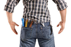 Rear view, studio shot of a man with tools Royalty Free Stock Photos