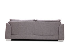 Rear view studio shot of a modern gray sofa Stock Photos