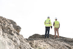 Rear view of supervisors standing at construction site against clear sky Royalty Free Stock Photo