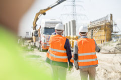 Rear view of supervisors walking at construction site Royalty Free Stock Photos