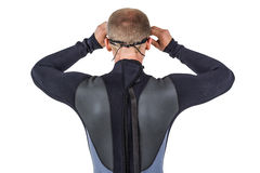 Rear view of swimmer in wetsuit wearing swimming goggles. On white background royalty free stock photography