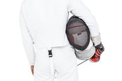 Rear view of swordsman holding fencing mask and sword. On white background Stock Image