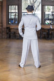 Rear View Of Tango Dancer In Restaurant. Full length rear view of male tango dancer standing in restaurant Stock Photos