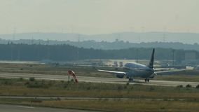Rear view of Tarom airlines Boeing 737 landing stock video footage