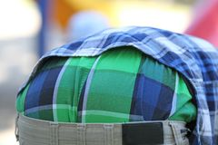 Rear view of teen guy in casuals. Green and blue plaid on rear view of teen boy in casuals Stock Photos