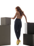 Rear view on topless girl in high-waisted trousers Stock Photos