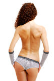 Rear view of topless girl in shorts and gloves. Stock Image