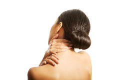 Rear view of topless woman with neck pain Royalty Free Stock Photo
