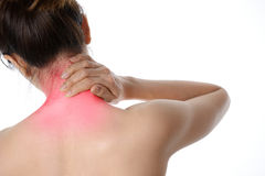 Rear view of a topless woman with neck pain standing isolated on Stock Photo