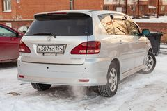 Rear view of Toyota Ipsum last generation in silver color after cleaning before sale in a winter day and snow background. Novosibirsk, Russia - 03.10.2019: Rear stock image