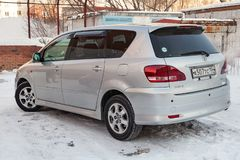 Rear view of Toyota Ipsum last generation in silver color after cleaning before sale in a winter day and snow background. Novosibirsk, Russia - 03.10.2019: Rear royalty free stock photo