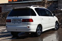 Rear view of Toyota Ipsum 1998 year in white color after cleaning before sale on parking. Novosibirsk, Russia - 04.10.2019: Rear view of Toyota Ipsum 1998 year royalty free stock photography