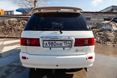 Rear view of Toyota Ipsum 1998 year in white color after cleaning before sale on parking. Novosibirsk, Russia - 04.10.2019: Rear view of Toyota Ipsum 1998 year stock image