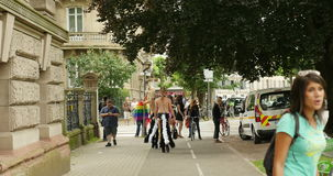 Rear view of transvestite walking at gay parade Strasbourg University stock video footage