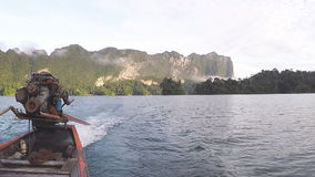 Rear view when travel on traditional Thai longtail boat stock footage
