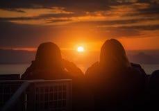 Rear view of Traveler couple woman looking sea at sunset in Shizuoka royalty free stock photo