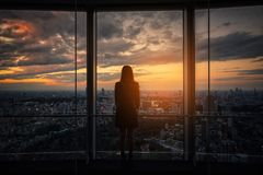 Rear view of Traveler woman looking Tokyo Skyline and view of sk stock photo