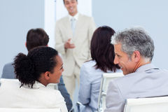 Rear view of two business people interacting Royalty Free Stock Photo
