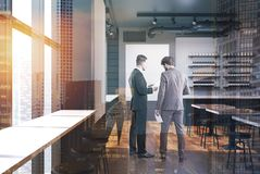 Business partners in a bar interior Royalty Free Stock Images