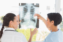Rear view of two female doctors examining xray Royalty Free Stock Image
